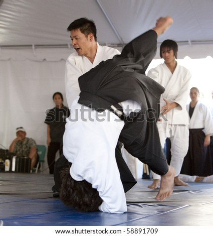 LOS ANGELES - APRIL 5:  Aikido practioners demonstrate self defense at the Little Tokyo Cherry Blossom Festival in Los Angeles on April 5th, 2009. - stock photo