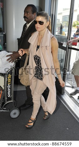 LOS ANGELES-APRIL 17: Black eyed Peas singer Fergie at LAX airport. April 17 in Los Angeles, California 2011