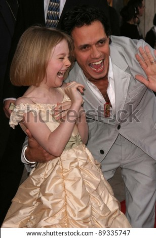 LOS ANGELES - APRIL 18: Dakota Fanning, Marc Anthony at the 'Man On Fire' premiere on April 18, 2004 in Westwood, Los Angeles, California - stock photo