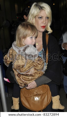 LOS ANGELES-APRIL 8: Famous daughter of Aaron Spelling, actress Tori Spelling with daughter at LAX airport. April 8 in Los Angeles, California 2011 - stock photo