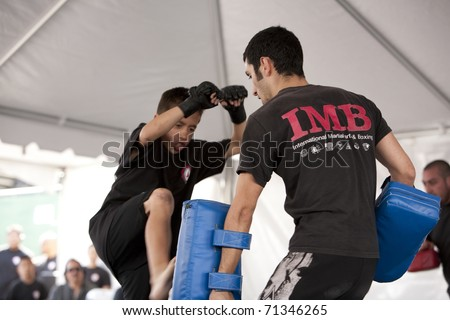 LOS ANGELES - APRIL 5:  Members of Torrance's IMB Academy demonstrate Thai Kickboxing at the Little Tokyo Cherry Blossom Festival on April 5th, 2009 in Los Angeles. - stock photo