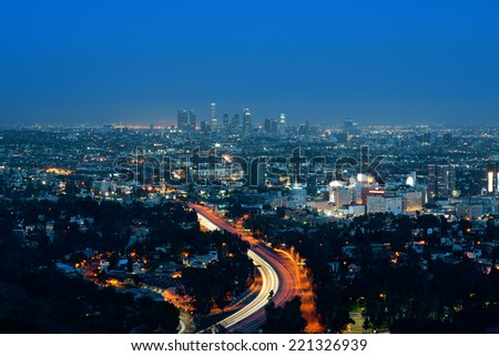 Los Angeles at night with urban buildings - stock photo