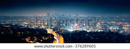 Los Angeles at night with urban buildings and highway