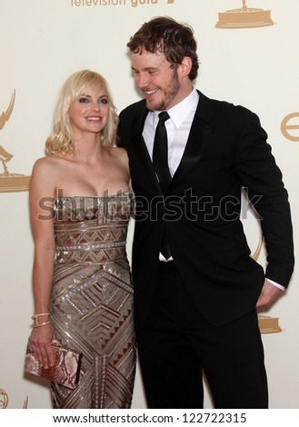 LOS ANGELES - AUG 11:  ANNA FARIS & CHRIS PRATT arriving to Emmy Awards 2011  on August 11, 2012 in Los Angeles, CA - stock photo