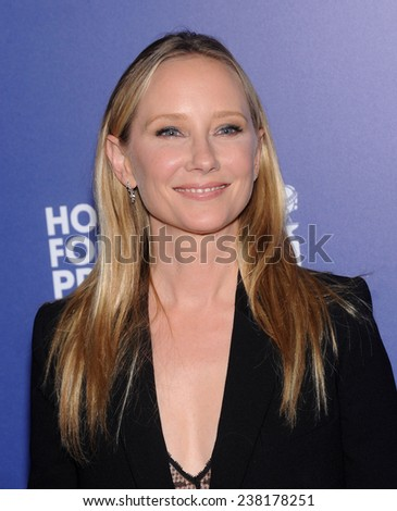 LOS ANGELES - AUG 14:  Anne Heche arrives to the HFPA Annual Installation Dinner 2014 on August 14, 2014 in Beverly Hills, CA                 - stock photo
