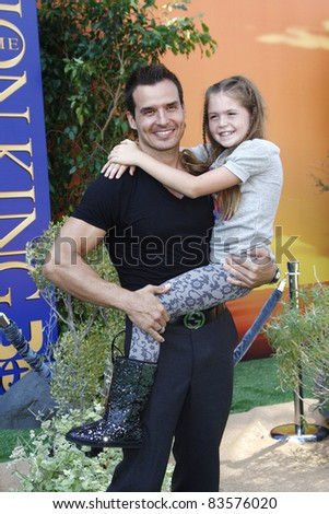 LOS ANGELES - AUG 27: Antonio Sabato Jr; daughter at the premiere of Walt Disney Studios' 'The Lion King 3D' on August 27, 2011 in Los Angeles, California - stock photo
