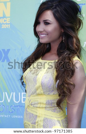 LOS ANGELES - AUG 7: Demi Lovato arrives at the 2011 Teen Choice Awards held at Gibson Amphitheatre on August 7, 2011 in Los Angeles, California - stock photo