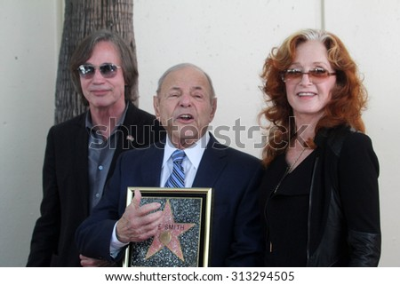 LOS ANGELES - AUG 27:  Jackson Browne, Joe Smith, Bonnie Raitt at the Joe Smith Star on the Hollywood Walk of Fame at the Capital Records Building on August 27, 2015 in Los Angeles, CA - stock photo