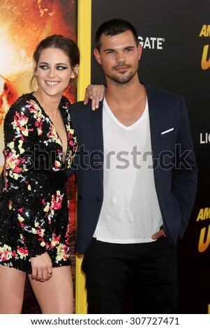 "LOS ANGELES - AUG 18:  Kristen Stewart, Taylor Lautner at the ""American Ultra"" Premiere at the Theater at Ace Hotel on August 18, 2015 in Los Angeles, CA - stock photo"