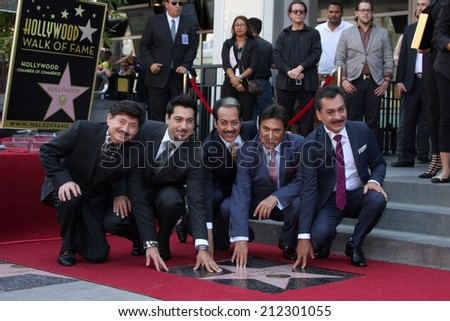 LOS ANGELES - AUG 21:  Los Tigres Del Norte at the Los Tigres Del Norte Honored On The Hollywood Walk Of Fame at Live Nation Building on August 21, 2014 in Los Angeles, CA - stock photo