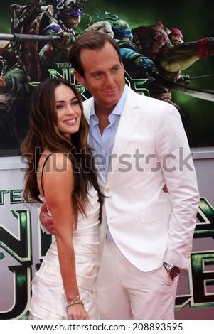 LOS ANGELES - AUG 3:  Megan Fox, Will Arnett at the Teenage Mutant Ninja Turtles Premiere at the Village Theater on August 3, 2014 in Westwood, CA - stock photo