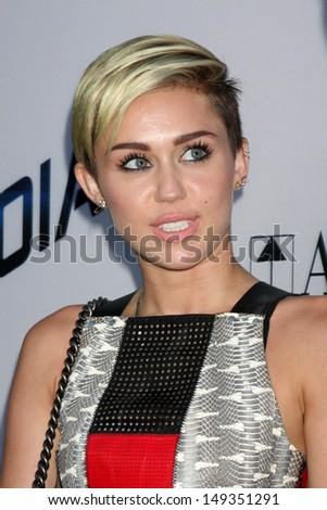 "LOS ANGELES - AUG 8:  Miley Cyrus arrives at the ""Paranoia"" Los Angeles Premiere at the Directors Guild of America on August 8, 2013 in Los Angeles, CA - stock photo"