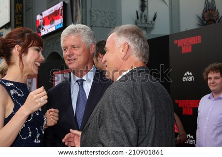 "LOS ANGELES - AUG 13:  Olga Kurylenko, Roger Donaldson, Bill Smitrovich at ""The November Man"" Premiere at TCL Chinese Theater on August 13, 2014 in Los Angeles, CA - stock photo"
