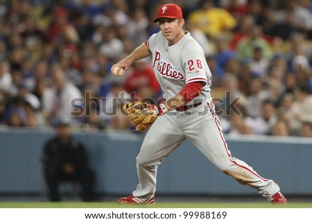 LOS ANGELES - AUG 31: Phillies 2B (26) Chase Utley fields a ground ball and throws to second during the MLB game on Aug 31 2010 at Dodgers Stadium. - stock photo