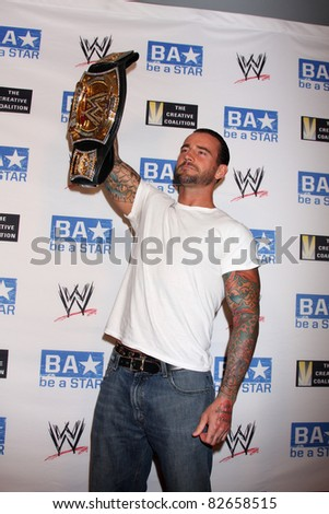"LOS ANGELES - AUG 11:  Phillip Jack Brooks aka CM Punk arriving at the ""be A STAR"" Summer Event at Andaz Hotel on August 11, 2011 in Los Angeles, CA - stock photo"