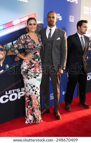 "LOS ANGELES - AUG 7:  Samara Saraiva, Damon Wayans Jr at the ""Let's Be Cops"" Premiere at the ArcLight Hollywood Theaters on August 7, 2014 in Los Angeles, CA  - stock photo"