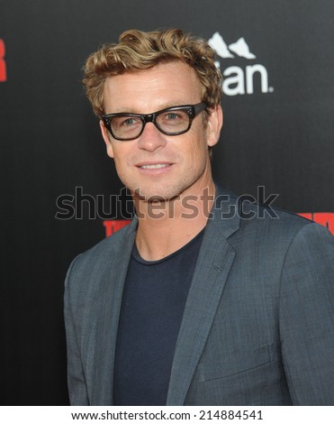 "LOS ANGELES - AUG 13:  Simon Baker arrives to the ""The November Man"" World Premiere  on August 13, 2014 in Hollywood, CA.                 - stock photo"