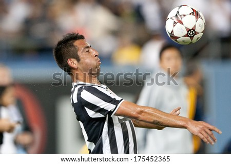 LOS ANGELES - AUGUST 3: Juventus M Mauricio Isla during the 2013 Guinness International Champions Cup game between Juventus and the Los Angeles Galaxy on Aug 3, 2013 at Dodger Stadium. - stock photo