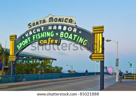 LOS ANGELES - AUGUST 3: Sign welcoming visitors to the Santa Monica pier located in Santa Monica, California on August 3, 2011. The amusement park on the pier is a world-famous tourist attraction. - stock photo