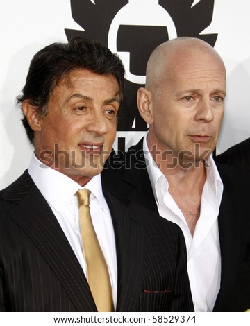 """LOS ANGELES - AUGUST 3:  Sylvester Stallone & Bruce Willis  arrives at """"The Expendables"""" LA Premiere at Grauman's Chinese Theater on August 3, 2010 in Los Angeles, CA - stock photo"""