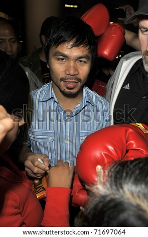 LOS ANGELES - AUGUST 30TH: Boxer Manny Pacquiao is seen at LAX . August 30th 2010 in Los Angeles, California - stock photo