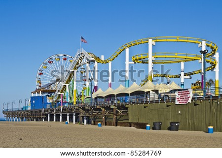 LOS ANGELES - August 3: The amusement park on the Santa Monica Pier in Santa Monica, California on August 3, 2011. A popular tourist attraction, the Pier is a familiar setting for many movies. - stock photo