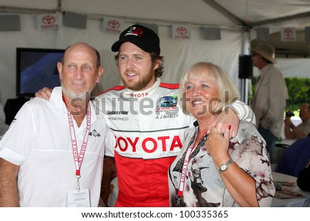 LOS ANGELES, CA - APR 16: Aj Buckley, Parents at the Toyota Grand Prix Pro Celeb Race at Toyota Grand Prix Track on April 16, 2011 in Long Beach, California
