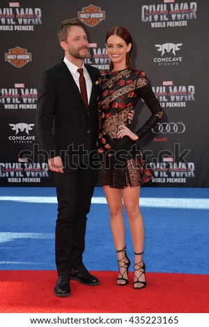 "LOS ANGELES, CA. April 12, 2016: Actor Chris Hardwick & actress fianc�½e Lydia Hearst at the world premiere of ""Captain America: Civil War"" at the Dolby Theatre, Hollywood.