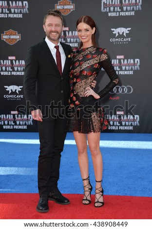 "LOS ANGELES, CA. April 12, 2016: Actor Chris Hardwick & actress fianc�©e Lydia Hearst at the world premiere of ""Captain America: Civil War"" at the Dolby Theatre, Hollywood.