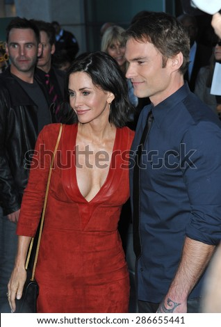 """LOS ANGELES, CA - APRIL 20, 2015: Courteney Cox & Seann William Scott at the premiere of their movie """"Just Before I Go"""" at the Arclight Theatre, Hollywood.  - stock photo"""