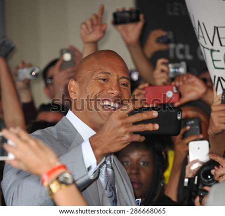 "LOS ANGELES, CA - APRIL 1, 2015: Dwayne ""The Rock"" Johnson at the world premiere of his movie ""Furious 7"" at the TCL Chinese Theatre, Hollywood.  - stock photo"