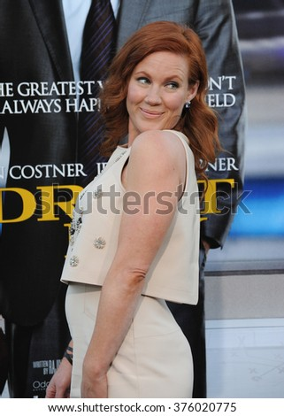"LOS ANGELES, CA - APRIL 7, 2014: Elisa Donovan at the Los Angeles premiere of ""Draft Day"" at the Regency Village Theatre, Westwood."