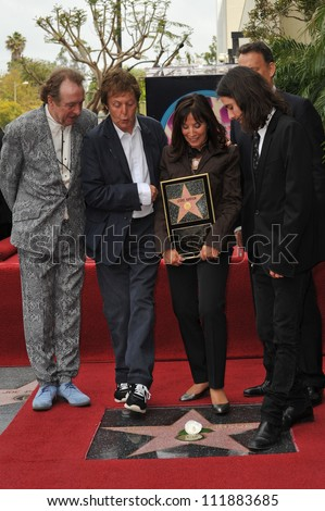 LOS ANGELES, CA - APRIL 14, 2009: Eric Idle, Paul McCartney, Olivia Harrison, Dhani Harrison & Tom Hanks at Hollywood Walk of Fame star ceremony honoring the late George Harrison. - stock photo