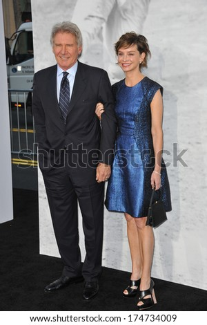 "LOS ANGELES, CA - APRIL 9, 2013: Harrison Ford & wife Calista Flockhart at the Los Angeles premiere of his new movie ""42: The True Story of An American Legend"" at the Chinese Theatre, Hollywood."