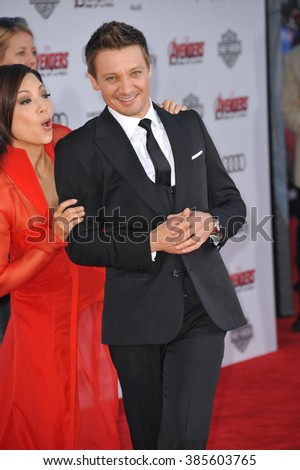 """LOS ANGELES, CA - APRIL 13, 2015: Jeremy Renner & Ming-Na Wen at the world premiere of his movie """"Avengers: Age of Ultron"""" at the Dolby Theatre, Hollywood. - stock photo"""