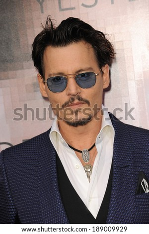 """LOS ANGELES, CA - APRIL 10, 2014: Johnny Depp at the Los Angeles premiere of his movie """"Transcendence"""" at the Regency Village Theatre, Westwood.  - stock photo"""