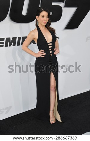 """LOS ANGELES, CA - APRIL 1, 2015: Katherine Castro at the world premiere of """"Furious 7"""" at the TCL Chinese Theatre, Hollywood.  - stock photo"""