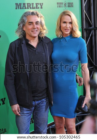 LOS ANGELES, CA - APRIL 17, 2012: Kelly Lynch & husband Mitch Glazer at the Los Angeles premiere of Marley at the Cinerama Dome, Hollywood. April 17, 2012  Los Angeles, CA - stock photo