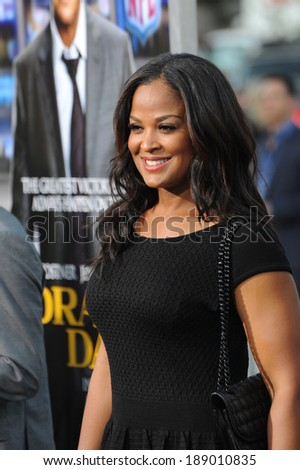 """LOS ANGELES, CA - APRIL 7, 2014: Laila Ali, daughter of Muhammed Ali, at the Los Angeles premiere of """"Draft Day"""" at the Regency Village Theatre, Westwood.  - stock photo"""