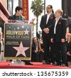 LOS ANGELES, CA - APRIL 5, 2013: Magicians Penn Jillette & Raymond Teller with David Copperfield on Hollywood Boulevard where they were honored with the 2,494th star on the Hollywood Walk of Fame - stock photo