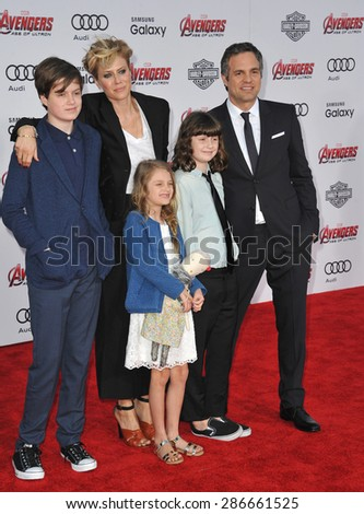 """LOS ANGELES, CA - APRIL 13, 2015: Mark Ruffalo & wife Sunrise Coigney & children at the world premiere of his movie """"Avengers: Age of Ultron"""" at the Dolby Theatre, Hollywood.  - stock photo"""