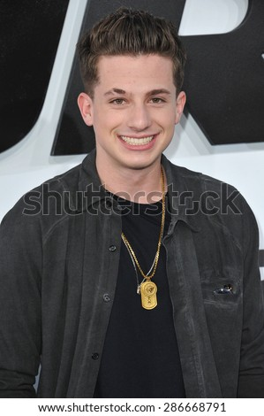 """LOS ANGELES, CA - APRIL 1, 2015: Musician Charlie Puth at the world premiere of """"Furious 7"""" at the TCL Chinese Theatre, Hollywood.  - stock photo"""