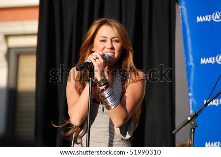 LOS ANGELES, CA- APRIL 28: Singer Miley Cyrus performs at The Grove for The Make A Wish Fundation concert series, April 28, 2010 in Los Angeles, CA. - stock photo