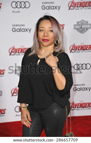 """LOS ANGELES, CA - APRIL 13, 2015: Tameka """"Tiny"""" Cottle-Harris at the world premiere of """"Avengers: Age of Ultron"""" at the Dolby Theatre, Hollywood.  - stock photo"""