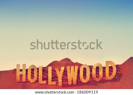 LOS ANGELES, CA - APRIL 3, 2014: the Hollywood sign cast in metal against blue sky and subtle overall vintage toning - stock photo