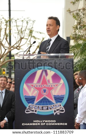 LOS ANGELES, CA - APRIL 14, 2009: Tom Hanks at Hollywood Walk of Fame star ceremony honoring the late George Harrison. - stock photo
