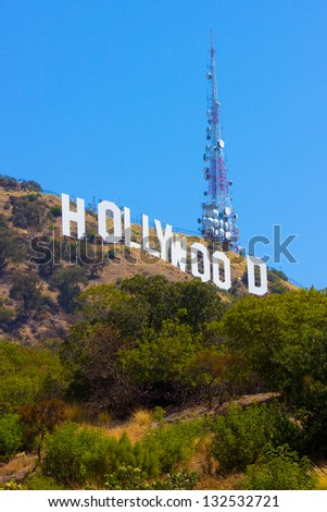 LOS ANGELES, CA - AUG 10:  Landmark Hollywood sign in the Hollywood hills seen on Aug 10, 2012. Erected in 1923 this iconic sign measures 450 feet long, with letters that are 45 feet high. - stock photo