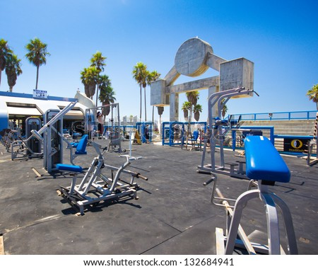 LOS ANGELES, CA - AUG 14:  Muscle Beach gym on Venice Beach, CA on Aug 14, 2012. Muscle Beach is a  landmark, outdoor gym dating back to the 1930's where celebrities and famous bodybuilders trained. - stock photo