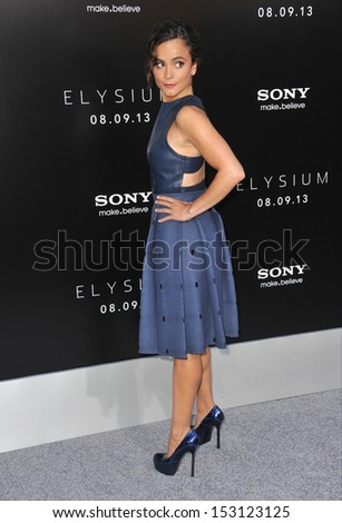 "LOS ANGELES, CA - AUGUST 7, 2013: Alice Braga at the world premiere of her movie ""Elysium"" at the Regency Village Theatre, Westwood.  - stock photo"