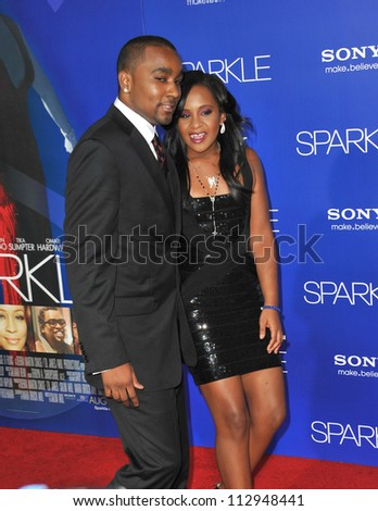 """LOS ANGELES, CA - AUGUST 16, 2012: Bobbi Kristina Brown (daughter of the late Whitney Houston) & Nick Gordon at the premiere """"Sparkle"""" at Grauman's Chinese Theatre, Hollywood. - stock photo"""